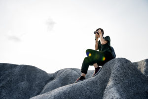 Woman taking picture on rocks