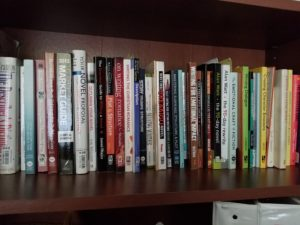 Lorri Dudley's bookshelf filled with writing books increasing her potential