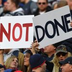 Patriot's fans hold Not Done sign