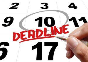 Deadline written on calendar with a circle date
