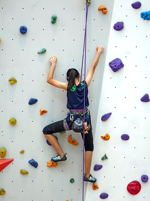 Woman indoor rock climbing