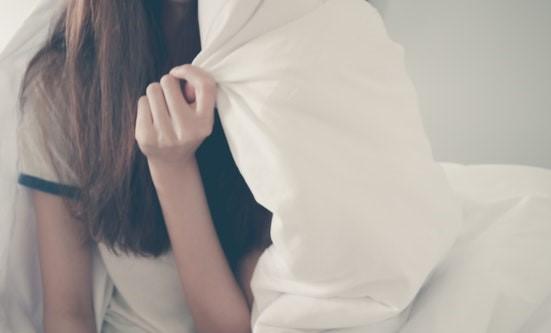 Girl hiding under comforter