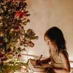 Girl under Christmas Tree