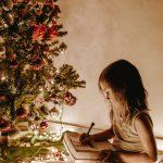 Girl under Christmas Tree