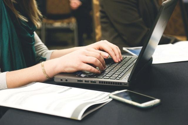 woman writing at computer